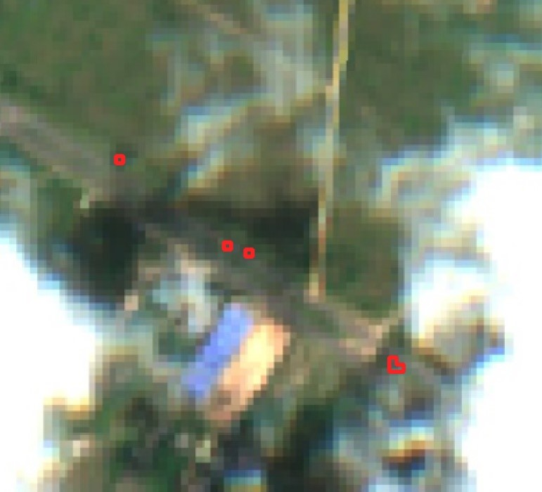 A pixelated image showing false positives in cloudy images, due to the refraction of light at the edge of clouds.